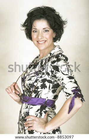 Beautiful happy adult woman with black curly hair and soft natural make-up - in her late thirties, early forties. - stock photo