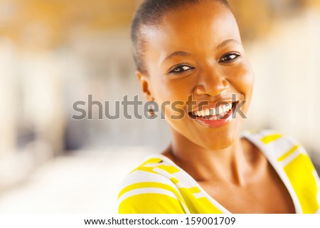 beautiful happy african american woman looking at the camera - stock photo