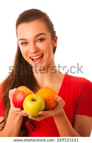 Beautiful happy asian caucasian woman in red t shirt holding apples and orange in her hands as a healthy eating and lifestyle concept isolated over white - stock photo