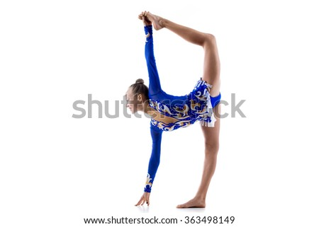 Beautiful happy ballerina teenage girl wearing dancer blue leotard working out, dancing, posing, doing balance art gymnastics exercise, standing splits, studio, white background, isolated, side view - stock photo