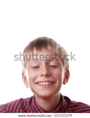 Beautiful happy blond boy in a red shirt with his eyes shut dreaming (isolated on white background) - stock photo