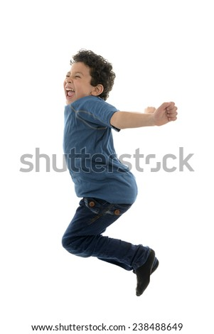 Beautiful Happy Boy Jumping Isolated on White Background - stock photo
