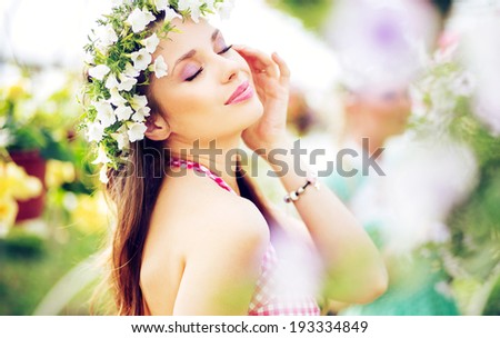 beautiful happy brunette woman in the park  - stock photo