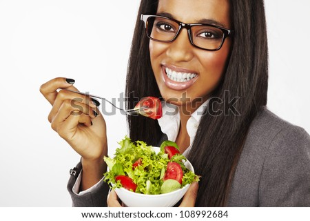 beautiful happy businesswoman eating salad isolated