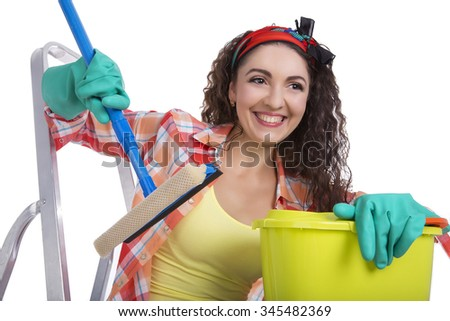 Beautiful happy caucasian girl with housekeeping cleaning tools. Isolated over white background