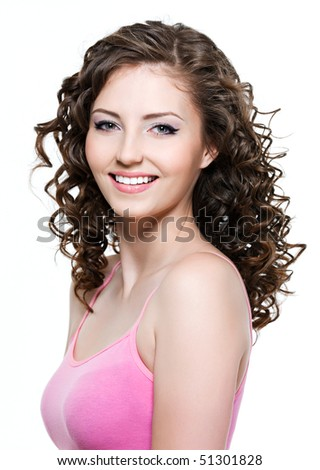 Beautiful happy cheerful young woman with brown curly hair - stock photo