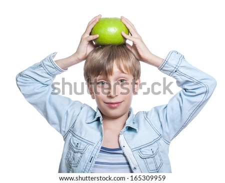 Beautiful happy child in stylish shirt shows a big sweetie holding it on his head smiling  (nutrition concept) - stock photo