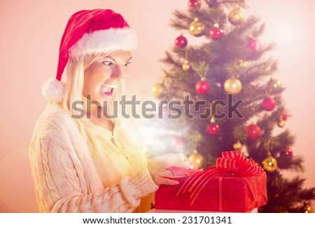 Beautiful happy christmas girl with Glowing Christmas Present. - stock photo