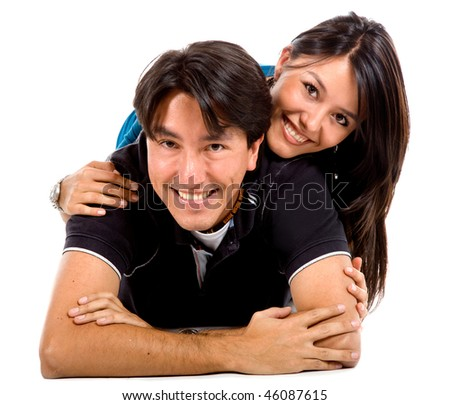 Beautiful happy couple isolated over a white background