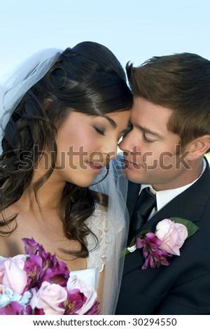 Beautiful happy couple on their wedding day - stock photo