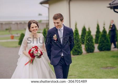beautiful happy couple on their wedding enjoying this moment - stock photo