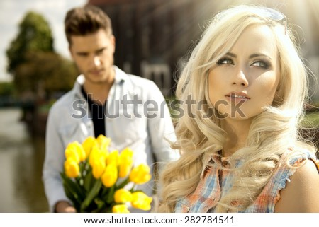 Beautiful happy couple with flowers  - stock photo