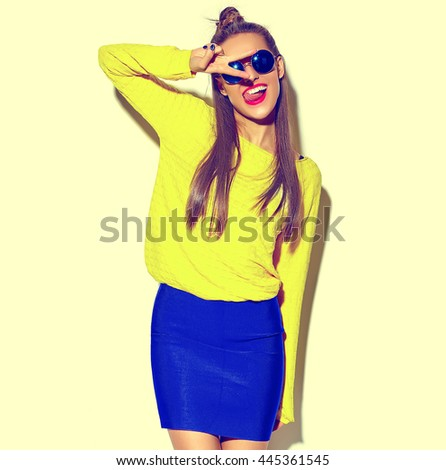 beautiful happy cute smiling brunette woman girl in casual colorful hipster yellow summer clothes with red lips isolated on white showing peace sign and her tongue