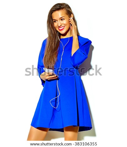 beautiful happy cute smiling sexy brunette woman girl in casual blue summer dress with red lips isolated on white listening to music and holding headphones - stock photo