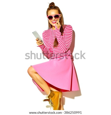 beautiful happy cute smiling sexy brunette woman girl in casual colorful pink summer clothes with red lips isolated on white listening to music  - stock photo