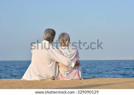 Beautiful happy elderly couple rest at tropical resort