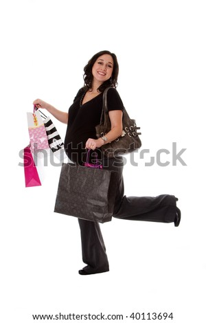 Beautiful happy exciting smiling Caucasian pregnant brunette woman holding shopping bags while walking and having her leg up, isolated - stock photo