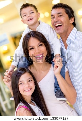 Beautiful happy family at the shopping center