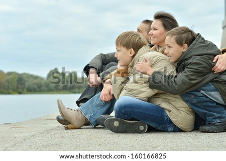 beautiful happy family for a walk in the park in autumn - stock photo