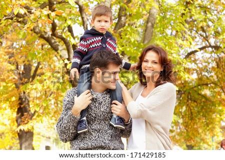 Beautiful happy family having fun outdoors isolated - stock photo