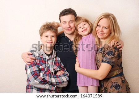 Beautiful happy family in studio - stock photo