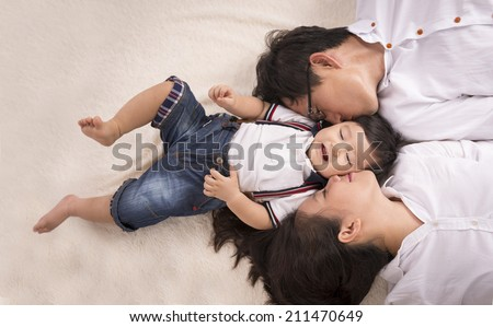 Beautiful happy family - isolated over a white background - stock photo