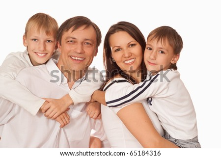 beautiful happy family of four on a light