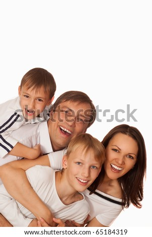 beautiful happy family of four on a light background