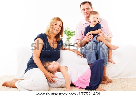 Beautiful happy family sitting in the living room.