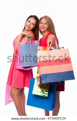 Beautiful happy friends mother daughter women standing together with colorful shopping bags, consumer lifestyle concept.