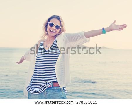 beautiful happy girl against the sea - stock photo
