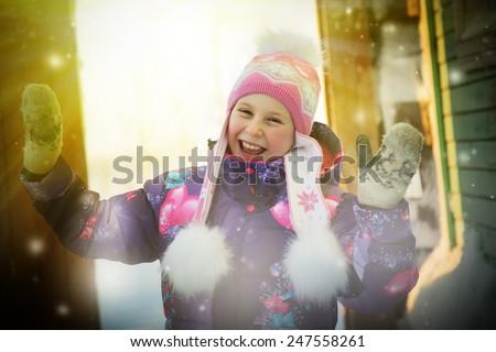 Beautiful happy girl dancing in the winter. - stock photo