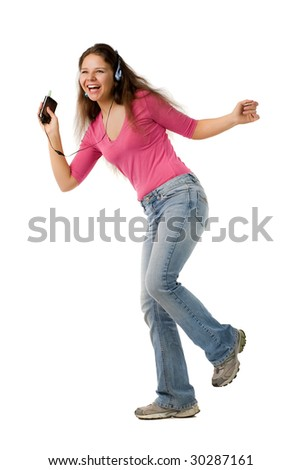 Beautiful happy girl in pink jacket and jeans dance with music player, isolated on white