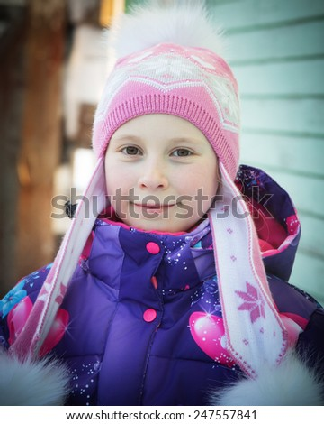 Beautiful happy girl in the  jacket in the winter. - stock photo