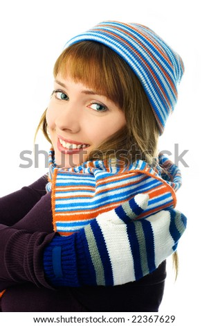 beautiful happy girl wearing a hat, mittens and scarf isolated against white background
