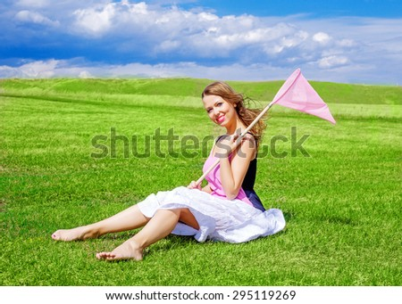 beautiful happy girl with a ring-net on a summer filed - stock photo