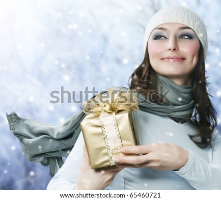 Beautiful Happy Girl with Christmas Gift.Snow - stock photo