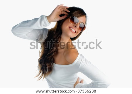 Beautiful happy girl with sunglasses isolated on white - stock photo