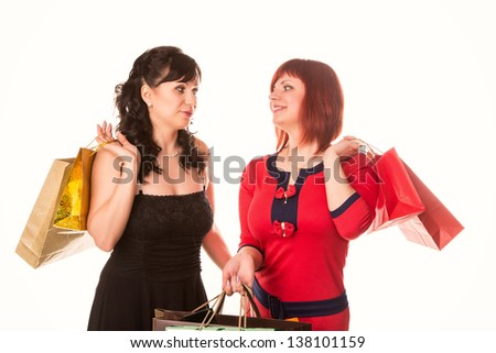 Beautiful happy girls with many shopping bags isolated on white. Shopping concept. - stock photo
