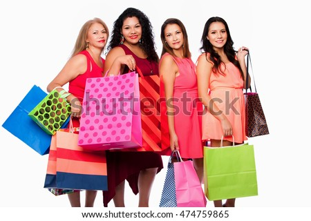 Beautiful happy Group of friends women standing with colorful shopping bags, consumer lifestyle concept.