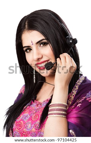 Beautiful Happy Indian Hindu Business Customer Service Representative at call center with headset microphone, isolated. - stock photo