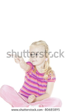 Beautiful Happy Little Blond Girl shows to the side - stock photo