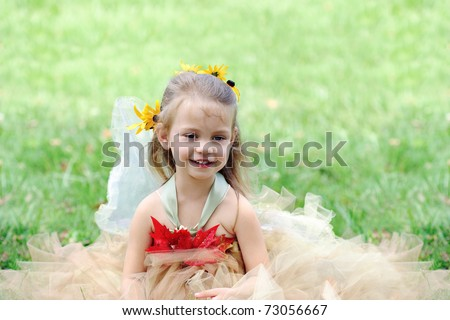 Beautiful happy little girl dressed in a fairy costume. - stock photo