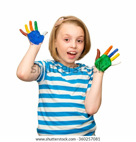 Beautiful happy little girl with hands in the paint. - stock photo
