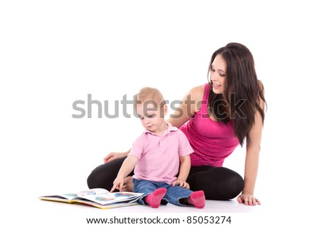 beautiful happy mother with child 2 years boy read book isolated on white - stock photo