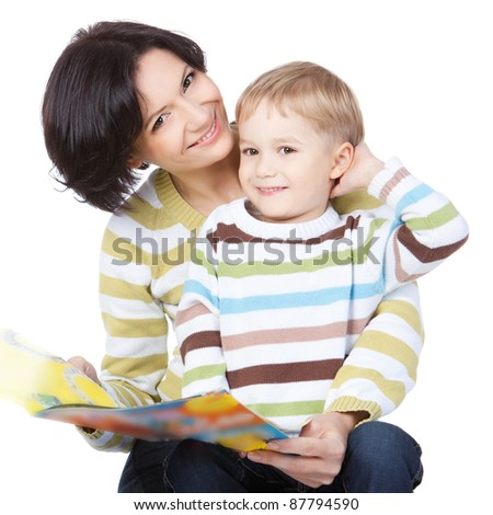 Beautiful happy mother with child 4 years boy read book isolated on white