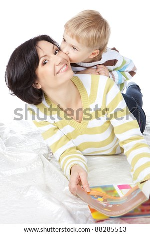 Beautiful happy mother with child 4 years boy read book isolated on white - stock photo