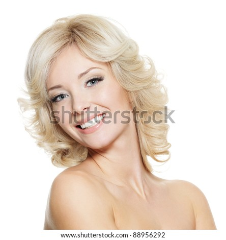 Beautiful happy portrait of an young adult blonde woman - isolated on white - stock photo