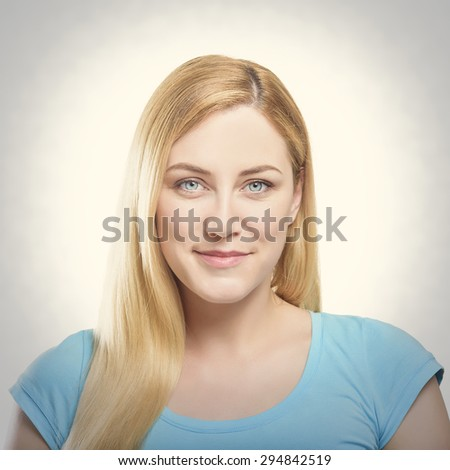 Beautiful happy portrait of an young adult blonde woman. Toned photo. - stock photo