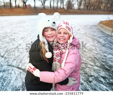beautiful happy preteen girl figure skating in open winter ice skating rink - stock photo